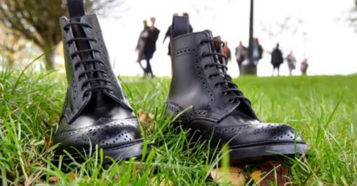 Black Tricker's boots on grass